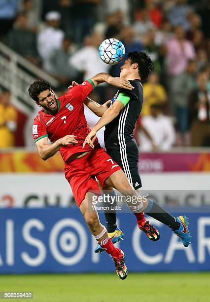 Wataru Ando of Japan is challenged for the ball by Ali Karimi of Iran during the AFC U23 Championship quarter final match between Japan and Iran at...