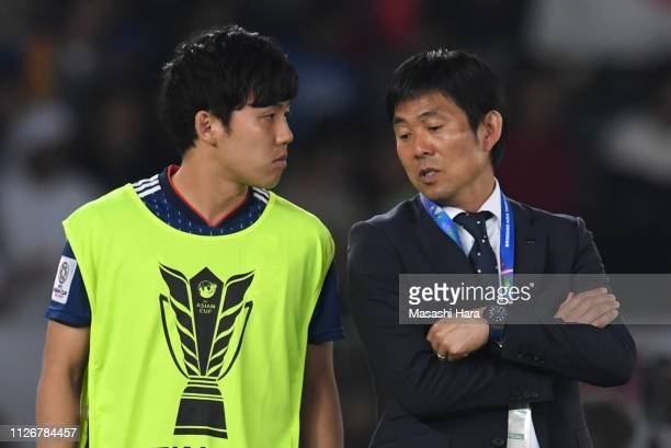 Wataru Endo and Hajime Moriyasu of Japan talk during the AFC Asian Cup final match between Japan and Qatar at Zayed Sports City Stadium on February...
