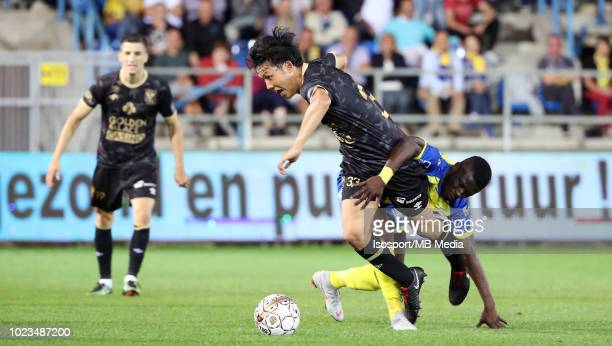 Wataru Endo and Nana Opoku Ampomah fight for the ball during the Jupiler Pro League match between WaaslandBeveren and SintTruidense VV at Freethiel...