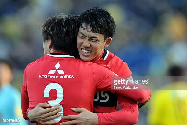 Wataru Endo and Tomoya Ugajin of Urawa Red Diamonds celebrate their win after the JLeague 2016 match between Kashiwa Reysol and Urawa Red Diamonds at...