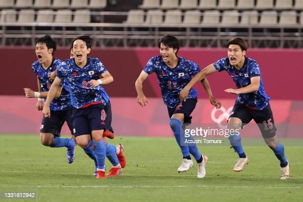 Wataru Endo, Koji Miyoshi, Kaoru Mitoma and Daiki Hashioka of Team Japan celebrate following their team's victory in the penalty shoot out during the...