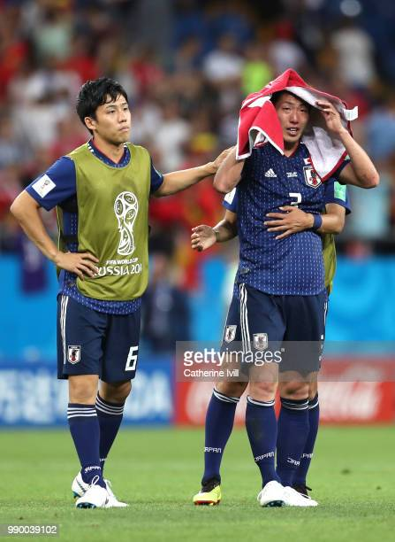 Wataru Endo of Japan and Gen Shoji of Japan look dejected following their sides defeat in the 2018 FIFA World Cup Russia Round of 16 match between...