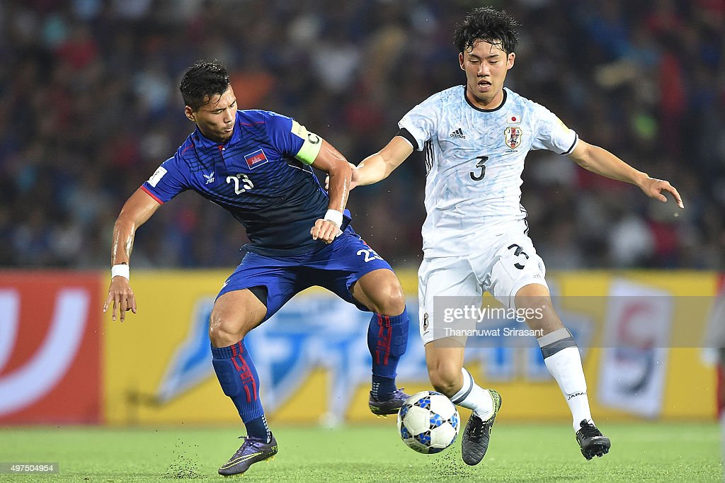 Wataru Endo #3 of Japan and Kouch Sokumpheak #23 of Cambodia competes for the ball during the 2018 FIFA World Cup Qualifier match between Cambodia and Japan on November 17, 2015 in Phnom Penh, Cambodia.