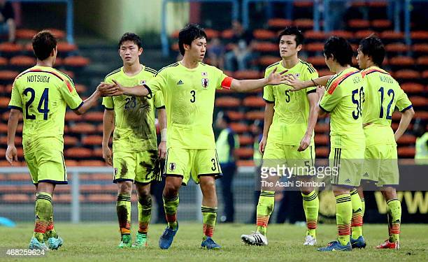 Wataru Endo of Japan and players celerbate their 10 win in the AFC U23 Championship qualifier Group I match between Japan and Malaysia at Shah Alam...