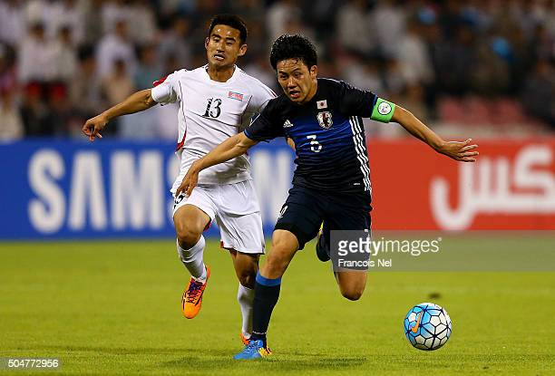 Wataru Endo of Japan battles for the ball with Jang Hyok of North Korea during the AFC U23 Championship Group B match between Japan and North Korea...