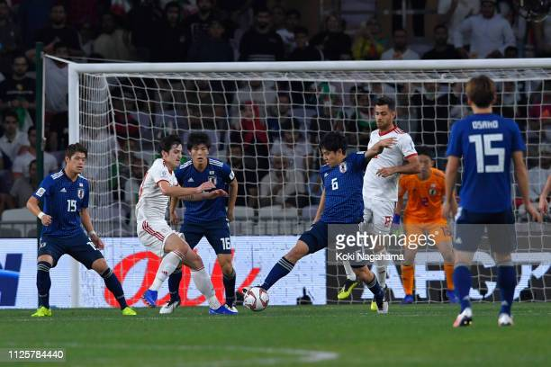 Wataru Endo of Japan cleres the ball during the AFC Asian Cup semi final match between Iran and Japan at Hazza Bin Zayed Stadium on January 28 2019...