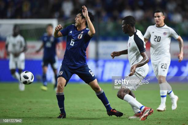 Wataru Endo of Japan competes for the ball during the international friendly match between Japan and Costa Rica at Suita City Football Stadium on...