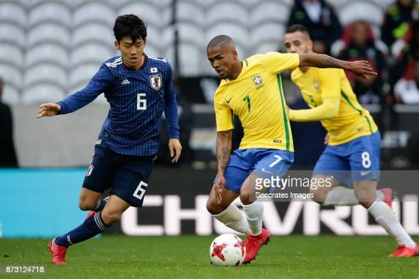 Wataru Endo of Japan Douglas Costa of Brazil during the International Friendly match between Japan v Brazil at the Stade Pierre Mauroy on November 10...