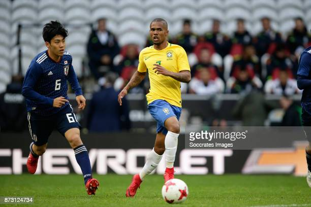Wataru Endo of Japan Douglas Costa of Brazil during the International Friendly match between Japan v Brazil at the Stade Pierre Mauroy on November 10...