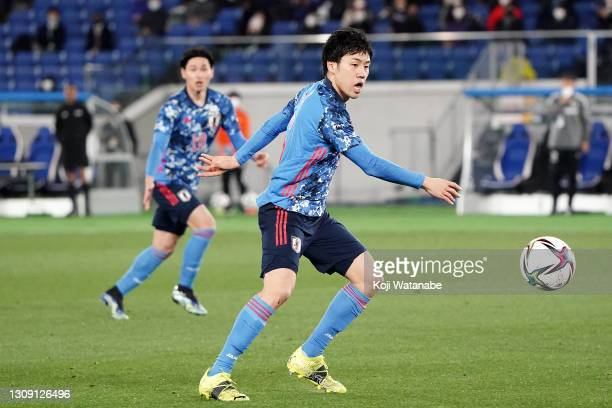 Wataru Endo of Japan in action during the international friendly match between Japan and South Korea at the Nissan Stadium on March 25, 2021 in...
