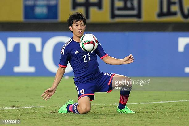 Wataru Endo of Japan in action in group match between Japan and South Korea during EAFF East Asian Cup 2015 at Wuhan Sports Center Stadium on August...