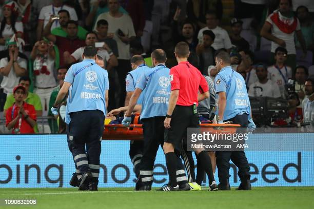 Wataru Endo of Japan is stretchered off with an injury during the AFC Asian Cup semi final match between Iran and Japan at Hazza Bin Zayed Stadium on...