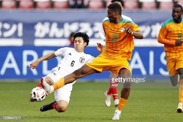 Wataru Endo of Japan, Juma Saeed of Ivory Coast during the friendly match between Japan and Ivory Coast at Stadium Galgenwaard on October 13, 2020 in...
