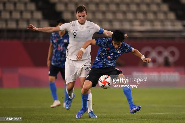 Wataru Endo of Japan keeps the ball under the pressure from Chris Wood of New Zealand during the Men's Quarter Final match on day eight of the Tokyo...