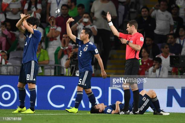 Wataru Endo of Japan lies injured during the AFC Asian Cup semi final match between Iran and Japan at Hazza Bin Zayed Stadium on January 28 2019 in...
