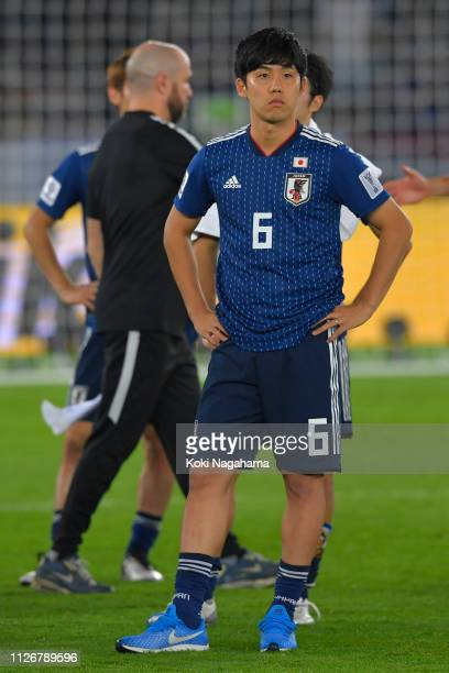 Wataru Endo of Japan looks dejected during the ceremony after losing the AFC Asian Cup final match between Japan and Qatar at Zayed Sports City...