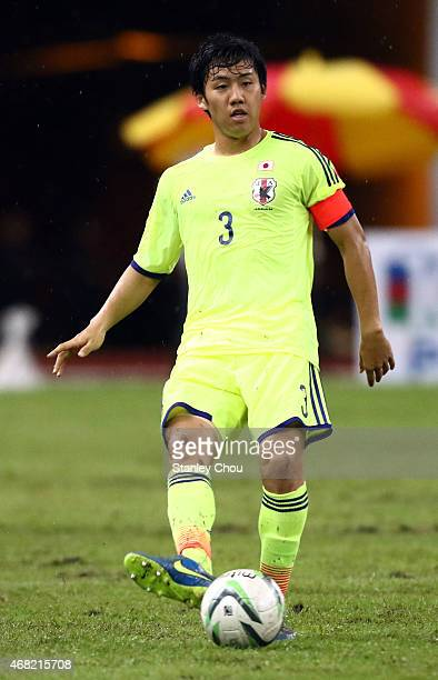 Wataru Endo of Japan passes the ball during the AFC U23 Championship qualifier Group I match between Japan and Malaysia at Shah Alam Stadium on March...