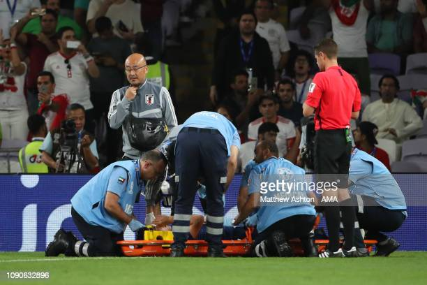 Wataru Endo of Japan receives treatment for an injury during the AFC Asian Cup semi final match between Iran and Japan at Hazza Bin Zayed Stadium on...