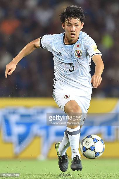 Wataru Endo of Japan runs with the ball during the 2018 FIFA World Cup Qualifier match between Cambodia and Japan on November 17 2015 in Phnom Penh...
