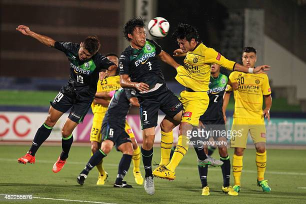 Wataru Endo of Shonan Bellmare and Daisuke Suzuki of Kashiwa Reysol compete for the ball during the J.League match between Shonan Bellmare and...