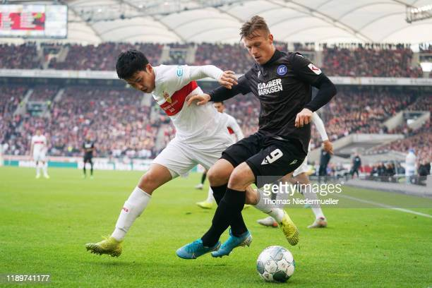 Wataru Endo of Stuttgart fights for the ball with Marvin Pourie of Karlsruhe during the Second Bundesliga match between VfB Stuttgart and Karlsruher...