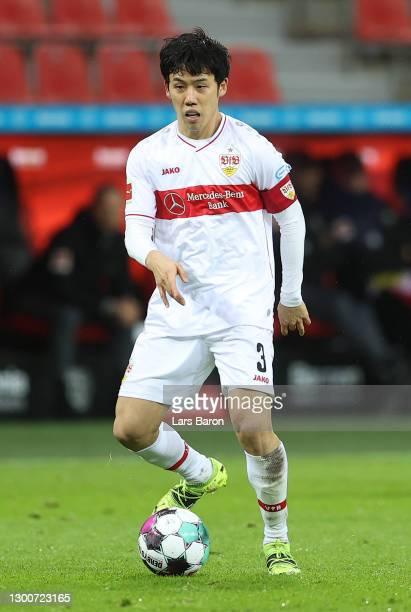 Wataru Endo of Stuttgart runs with the ball during the Bundesliga match between Bayer 04 Leverkusen and VfB Stuttgart at BayArena on February 06,...
