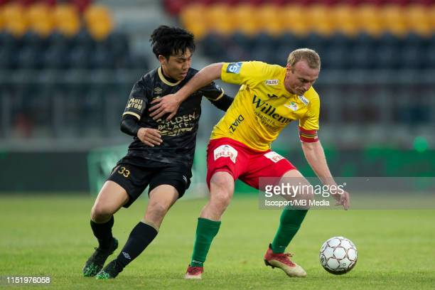 Wataru Endo of STVV and Kevin Vandendriessche of Kv Oostende fight for the ball during the Jupiler Pro League playoff 2 group A match between KV...