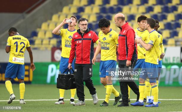 Wataru Endo of STVV suffers an injury during the Jupiler Pro League playoff 2 group A match between Stvv and Kvc Westerlo on May 18 2019 in...