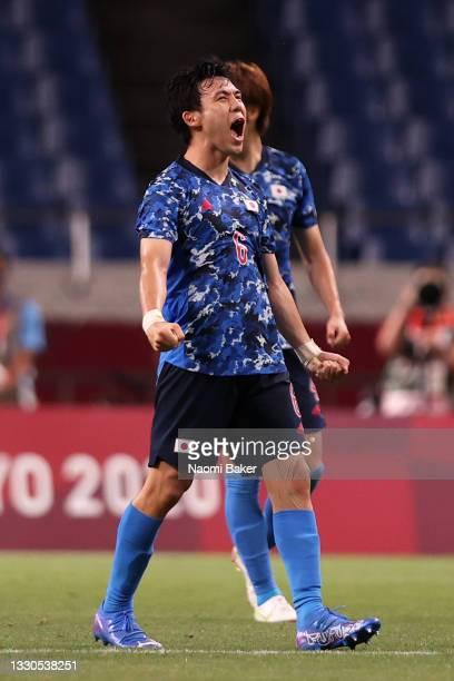 Wataru Endo of Team Japan celebrates their side's victory after the Men's First Round Group A match between Japan and Mexico on day two of the Tokyo...