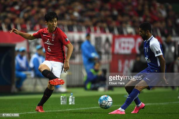 Wataru Endo of Urawa Red Diamonds and Salman Al Faraj of AlHilal compete for the ball during the AFC Champions League Final second leg match between...