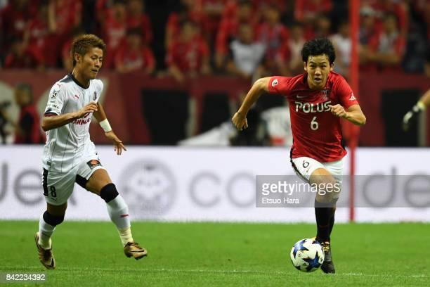 Wataru Endo of Urawa Red Diamonds and Yoichiro Kakitani of Cerezo Osaka compete for the ball during the JLeague Levain Cup quarter final second leg...