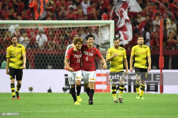 Wataru Endo of Urawa Red Diamonds celebrstes the second goal with Toshiyuki Takagi during the preseason friendly match between Urawa Red Diamonds and...