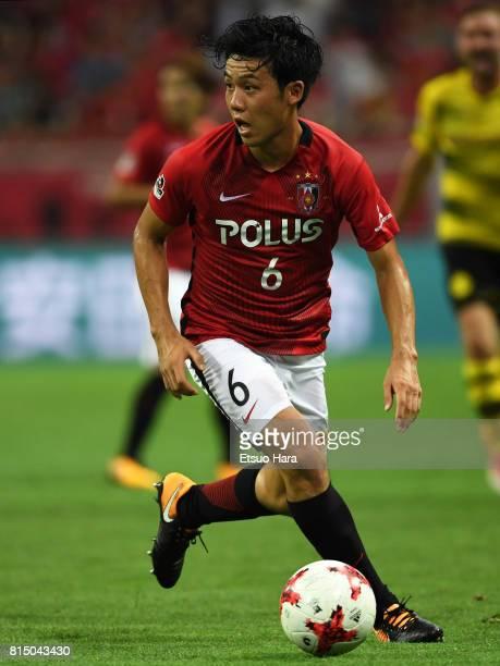 Wataru Endo of Urawa Red Diamonds in action during the preseason friendly match between Urawa Red Diamonds and Borussia Dortmund at Saitama Stadium...