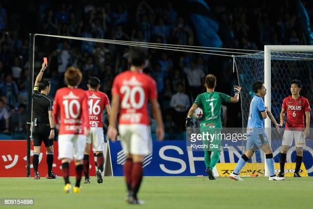 Wataru Endo of Urawa Red Diamonds is shown a red card by referee Masaaki Iemoto during the J.League J1 match between Kawasaki Frontale and Urawa Red...