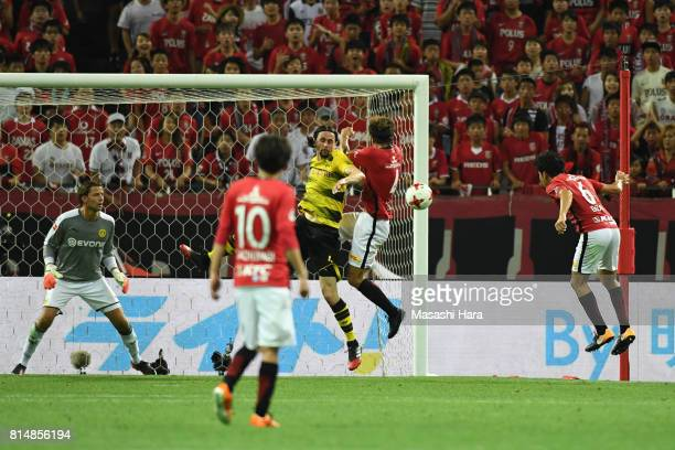 Wataru Endo of Urawa Red Diamonds scores the second goal during the preseason friendly match between Urawa Red Diamonds and Borussia Dortmund at...