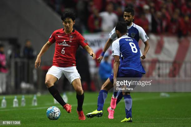 Wataru Endo of Urawa Red Diamonds takes on AlHilal defense during the AFC Champions League Final second leg match between Urawa Red Diamonds and...