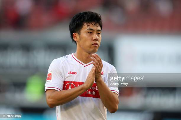 Wataru Endo of VfB Stuttgart acknowledges the fans following the Bundesliga match between VfB Stuttgart and Bayer 04 Leverkusen at Mercedes-Benz...
