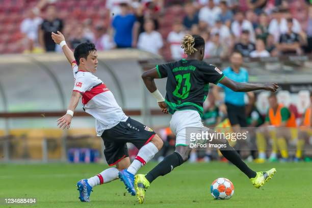 Wataru Endo of VfB Stuttgart and Gideon Jung of SpVgg Greuther Fuerth battle for the ball during the Bundesliga match between VfB Stuttgart and SpVgg...