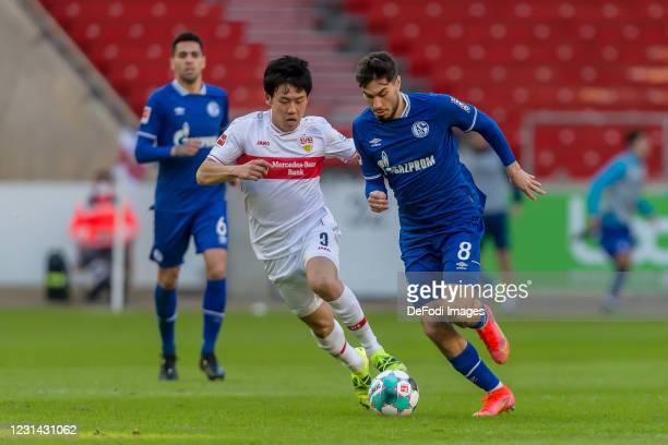 Wataru Endo of VfB Stuttgart and Suat Serdar of FC Schalke 04 battle for the ball during the Bundesliga match between VfB Stuttgart and FC Schalke 04...