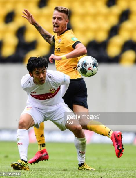 Wataru Endo of VfB Stuttgart battles for possession with Ondrej Petrak of Dynamo Dresden during the Second Bundesliga match between SG Dynamo Dresden...