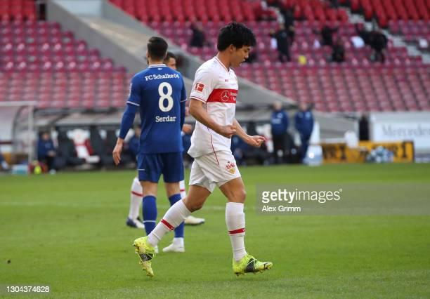 Wataru Endo of VfB Stuttgart celebrates after scoring his team's first goal during the Bundesliga match between VfB Stuttgart and FC Schalke 04 at...