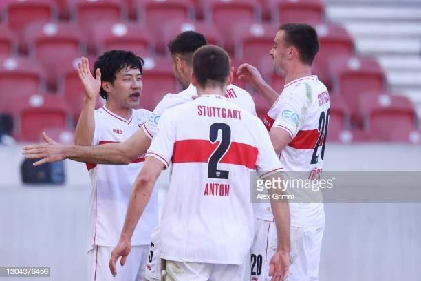 Wataru Endo of VfB Stuttgart celebrates with teammates after scoring his team's second goal during the Bundesliga match between VfB Stuttgart and FC...