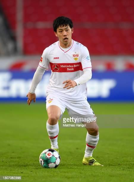 Wataru Endo of VfB Stuttgart controls the ball during the Bundesliga match between VfB Stuttgart and TSG Hoffenheim at Mercedes-Benz Arena on March...