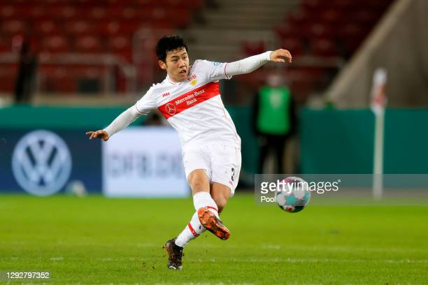 Wataru Endo of VfB Stuttgart passes the ball during the DFB Cup second round match between VfB Stuttgart and SC Freiburg at Mercedes-Benz Arena on...