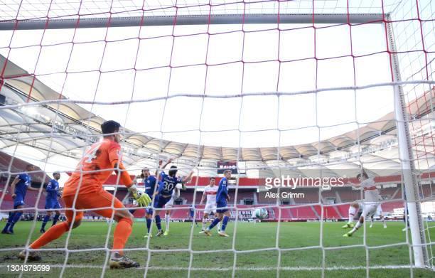 Wataru Endo of VfB Stuttgart scores his team's first goal past Michael Langer of FC Schalke 04 during the Bundesliga match between VfB Stuttgart and...