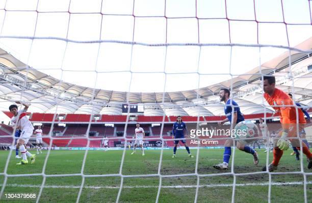 Wataru Endo of VfB Stuttgart scores his team's second goal past Michael Langer of FC Schalke 04 during the Bundesliga match between VfB Stuttgart and...