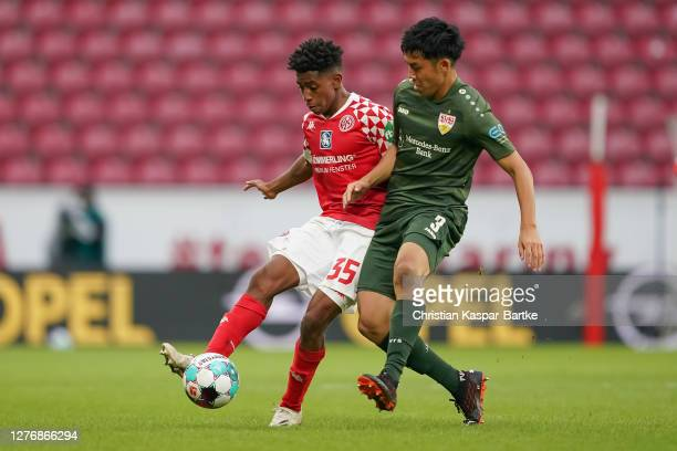 Wataru Endo of VfB Stuttgart tackles Leandro Barreiro Martins of 1.FSV Mainz 05 during the Bundesliga match between 1. FSV Mainz 05 and VfB Stuttgart...