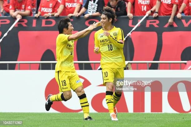 Wataru Esaka and Yusuke Segawa of Kashiwa Reysol celebrate the first goal during the JLeague J1 match between Urawa Red Diamonds and Kashiwa Reysol...