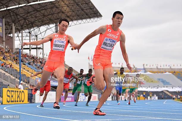 Wataru Inuzuka and Jun Yamashita of Japan compete in men's 100 metres relay during the IAAF World U20 Championships at the Zawisza Stadium on July 22...