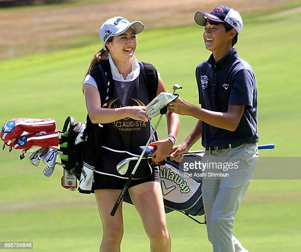 Wataru Ishikawa of Japan talks with his caddie and sister Yoko during the first round of the RIZAP KBC Augusta at Keya Golf Club on August 25 2016 in...